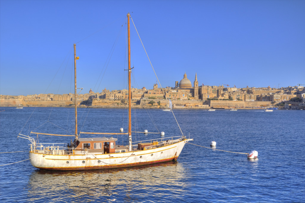 Sailboat and the city of Valletta in Malta.